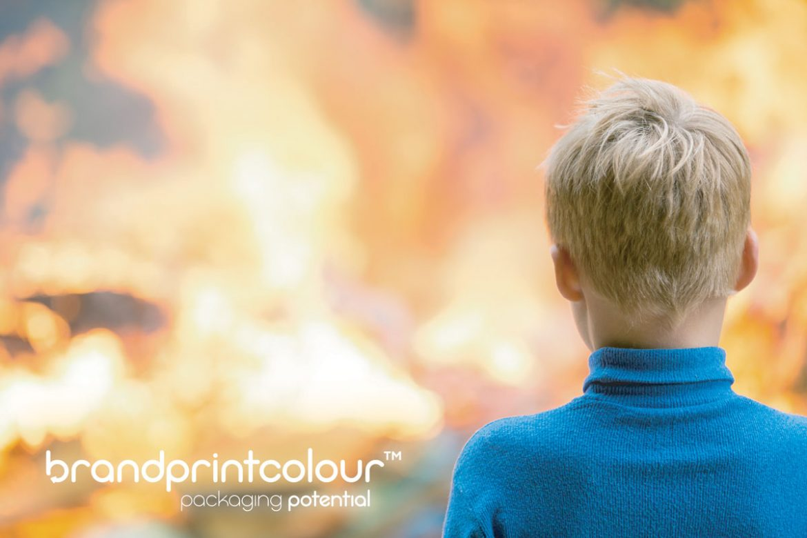 boy looking at a fire